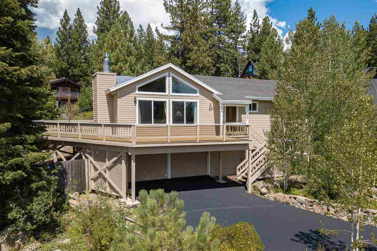 Breathtaking views from the wrap around deck will captivate you while relaxing after a fun day of playing in Tahoe. Featuring 4 bedrooms, 3 baths and an open floor plan that looks out at the lake, this home is an amazing Tahoe City opportunity! Southern exposure gives plenty of sunshine all day. Walk to beaches and a short bike ride to trails and Tahoe City. This is a must see!